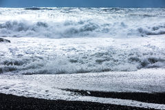 Waves on the black beach of Reynisfjara in Iceland Royalty Free Stock Photography