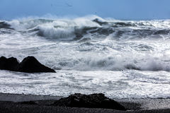 Waves on the black beach of Reynisfjara in Iceland Royalty Free Stock Photos