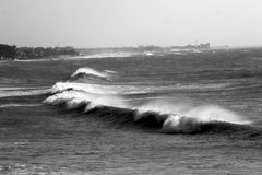 Waves black and white. Storm in the sea with waves deliberately out of focus to give effect movement (panning royalty free stock images