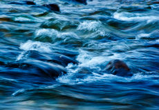 Waves. Blue waves in a creek at fiumefreddo of Sicily Royalty Free Stock Photos