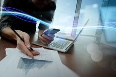 Waves of blue light and businessman using on smartphone as concept royalty free stock photography