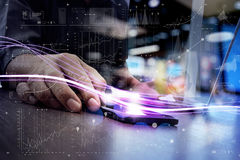 Waves of blue light and businessman using on smartphone as concept stock image