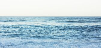 Waves of blue quiet ocean coast landscape. Background sea scape and sand beach coastline. Panorama horizon perspective view nature. Hiliday. Travel summer royalty free stock photos
