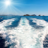 Waves on blue sea behind the boat Royalty Free Stock Photos