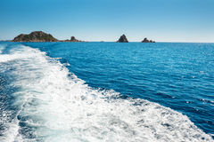 Waves on blue sea behind the boat Royalty Free Stock Photography