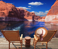 Waves from the boat dissect lake Powell. Waves from the boat dissect the lake Powell on the river Colorado. Aft vessels cost two chaise lounges. On a back of one Stock Image