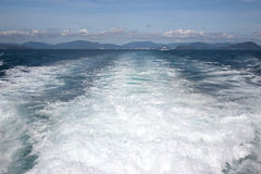 Waves from the boat. Engine running Royalty Free Stock Photos
