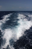 Waves from boats. Deep blue ocean water stock images