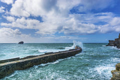 Waves braking on portreath breakwater at  Cornwall Royalty Free Stock Image