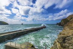 Waves braking on portreath breakwater at  Cornwall Royalty Free Stock Photo