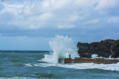 Waves braking on portreath breakwater at  Cornwall Stock Photography