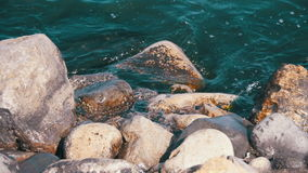 Waves Break Against the Rocks at Sea in Slow Motion stock video footage