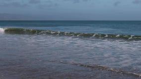 Loop With Ocean Waves Breaking On A Sandy Beach Stock Footage