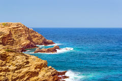 Waves break on rocky shore. Bali, Crete Royalty Free Stock Photos