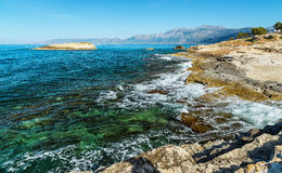 Waves break on rocky shore. Raging sea an elemental power in storm. Clear day at sea coast. Royalty Free Stock Photo