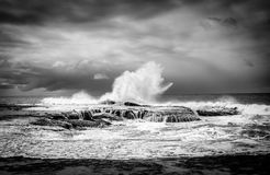 Waves breaking at Anglesea beach in Victoria, Australia. Dramatic black and white of waves breaking at Anglesea beach, Great Ocean Road, Victoria, Australia Stock Photography