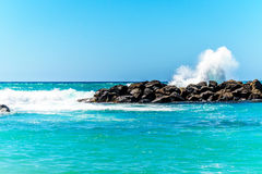 Waves breaking on the barriers of the lagoons at the resort community of Ko Olina Royalty Free Stock Photography