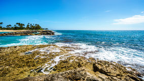 Waves breaking on the barriers of the lagoons at the resort community of Ko Olina Royalty Free Stock Photos