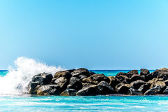 Waves breaking on the barriers of the lagoons at the resort community of Ko Olina Stock Photo