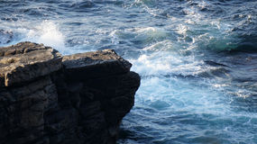 Waves breaking at the base of the Cliffs on Banba's Crown, Malin Royalty Free Stock Photos
