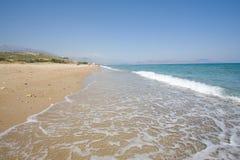 Waves breaking on beach Stock Image