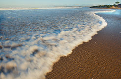 Waves breaking on beach. Scenic view of waves breaking on sandy beach, Haretenbos, Garden Route, South Africa Stock Image