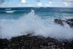 Waves breaking on beach. Details of waves breaking on rocky beach royalty free stock photos