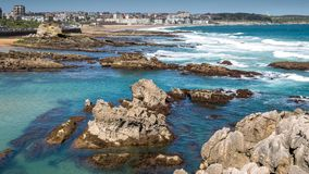 Waves breaking in the beach. Panoramic view of waves breaking at Sardinero beach in Santander (Cantabria, Spain Stock Photos