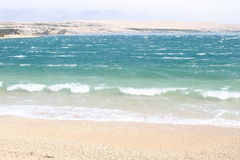 Waves breaking on a beach. Scenic view of waves breaking on the beach of Pag Island, Croatia Royalty Free Stock Photos