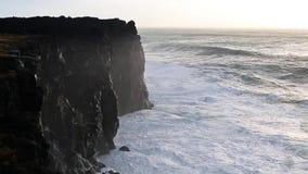 Waves breaking on black rocks in Iceland stock video footage