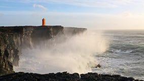 Waves breaking on black rocks in Iceland stock video