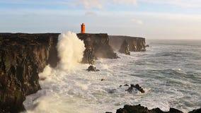 Waves breaking on black rocks in Iceland stock footage