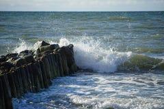 Waves breaking on breakwater. Waves breaking on a breakwater at the Baltic sea Stock Photo