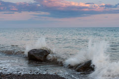 Waves breaking on coastal rocks. Royalty Free Stock Images