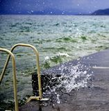 The waves breaking on a concrete embankment on lake ohrid, macedonia Stock Photo
