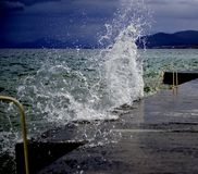 The waves breaking on a concrete embankment on lake ohrid, macedonia Stock Images