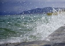 The waves breaking on a concrete embankment on lake ohrid, macedonia Royalty Free Stock Photos