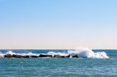 Waves breaking on the a foreland Stock Image