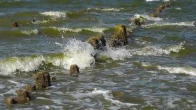 Waves breaking on old pier stock footage
