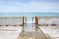 Waves breaking on the old pier. Royalty Free Stock Photo