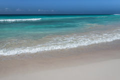 Waves breaking onto the shore in Barbados. Royalty Free Stock Photo