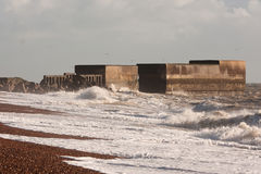 Waves breaking over rock & concrete breakwater Stock Image