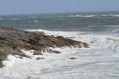 Waves breaking over rocks near Mumbles, Wales, UK Stock Photography