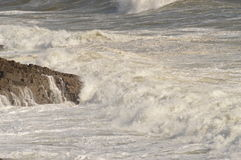 Waves breaking over rocks near Mumbles, Wales, UK Royalty Free Stock Photography