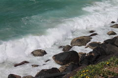 Waves breaking over the rocks in thev iew down from Danger Point, Queensland, Royalty Free Stock Photography