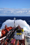 Waves breaking over tanker Royalty Free Stock Photos