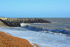 Waves breaking. A photo of waves breaking against a sea defence wall Royalty Free Stock Photos