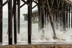 Waves breaking on the poles under the pier of San Simeon, California, USA stock photo