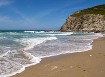 Waves breaking on Porthtowan beach. Royalty Free Stock Photo