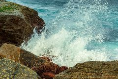 Waves breaking on Rock Formation on the Coastline at Pebbly Beach NSW royalty free stock photos